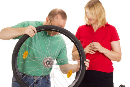 A mechanic repairs the wheel of a bicycle Stock Photo - 15266331