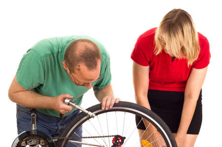 A mechanic repairs the wheel of a bicycle Stock Photo - 15266329
