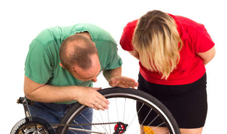 A mechanic repairs the wheel of a bicycle Stock Photo - 15266300