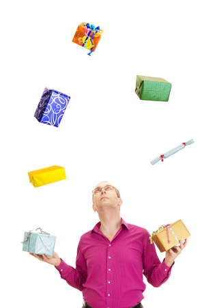 A business person juggling with some colorful gifts photo