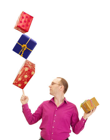 Business person balancing three gifts photo