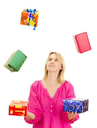 Woman juggling with some colorful gifts photo