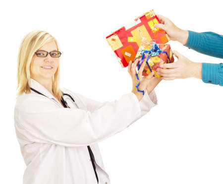 Medical doctor grabbing two gifts Stock Photo