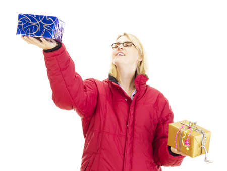 A female person juggling with two colorful gifts photo