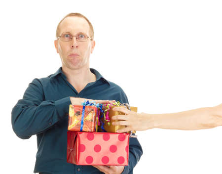 A person takes a gift from a business person photo