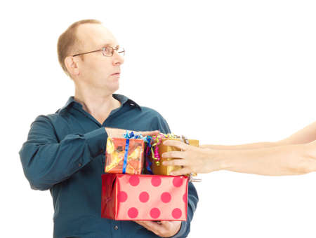 payoff: A person takes a gift from a business person Stock Photo