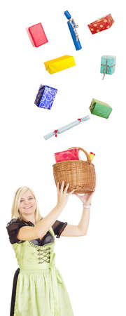 traditional costume: Young woman in traditional costume catching gifts Stock Photo