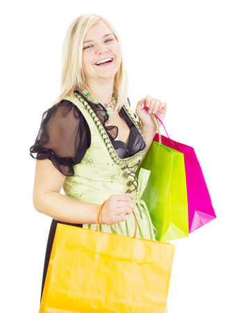 Woman in traditional costume with shopping bags photo