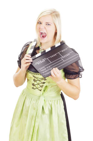 Woman in dirndl with clapperboard photo
