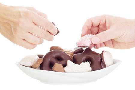 titbits: People eating some delicate gingerbreads Stock Photo