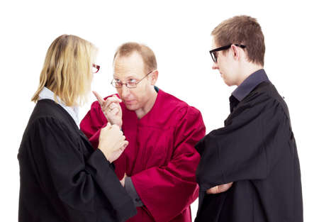 jurists: Three jurists debate about a lawsuit Stock Photo