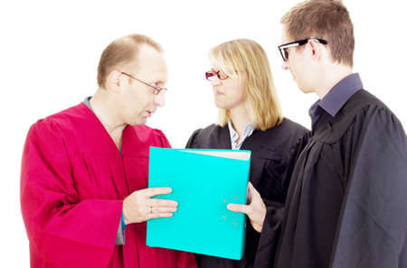 jurists: Three jurists analysing some facts Stock Photo