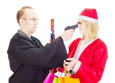 payoff: Layer hold santa claus at gunpoint Stock Photo