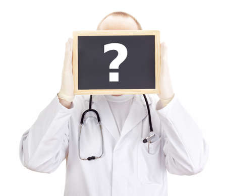 Doctor shows information on blackboard: question mark Stock Photo