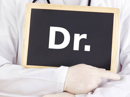 Doctor shows information on blackboard: dr photo