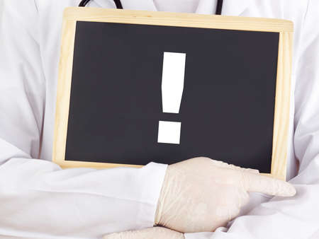 Doctor shows information on blackboard: exclamation point