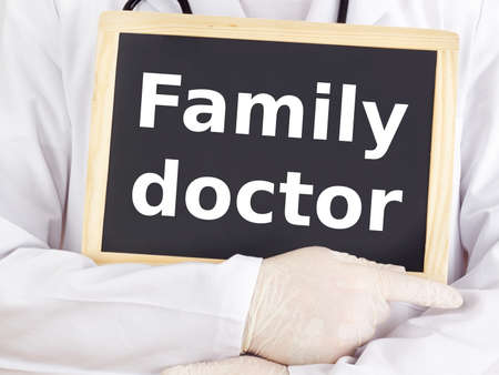 Doctor shows information on blackboard: family doctor photo
