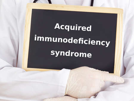 acquired: Doctor shows information on blackboard: acquired immunodeficiency syndrome