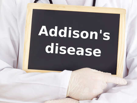 Doctor shows information on blackboard: addison`s disease
