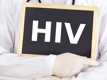 aids: Doctor shows information on blackboard: hiv Stock Photo