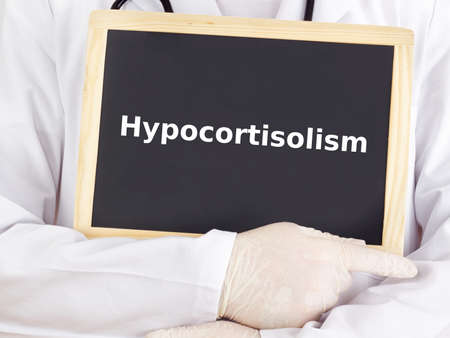 Doctor shows information on blackboard: hypocortisolism Stock Photo - 15864377