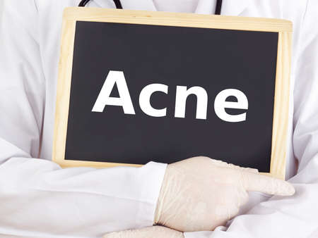 cystic: Doctor shows information on blackboard: acne