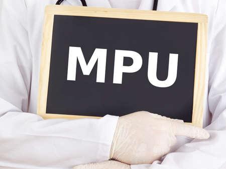 Doctor shows information on blackboard: mpu