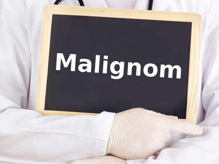 malignant neoplasm: Doctor shows information on blackboard: cancer Stock Photo