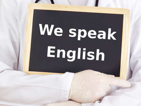 Doctor shows information: we speak english Stock Photo