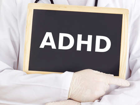 Doctor shows information on blackboard: adhd photo