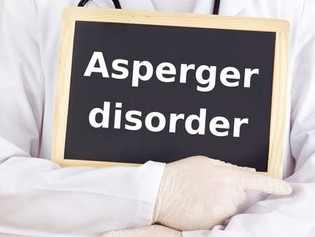 asperger: Doctor shows information: asperger disorder Stock Photo