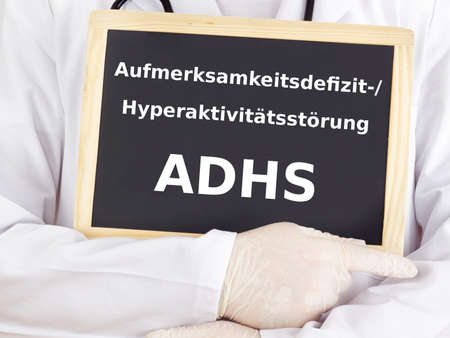 Doctor shows information on blackboard: adhs
