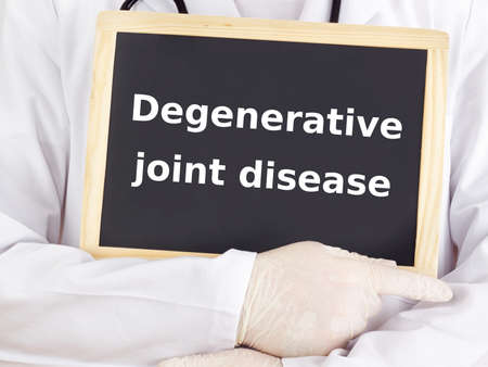 degenerative: Doctor shows information: degenerative joint disease Stock Photo