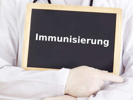 immunization: Doctor shows information: immunization Stock Photo