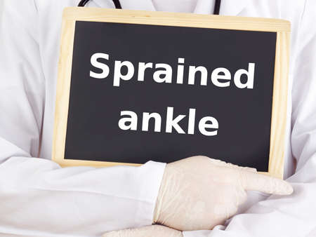 sprained: Doctor shows information: sprained ankle Stock Photo