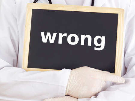 Doctor shows information on blackboard: wrong