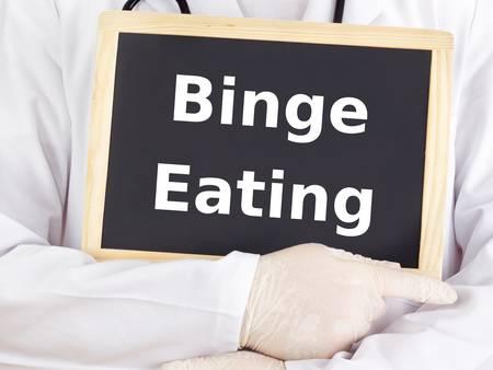 Doctor shows information: binge eating