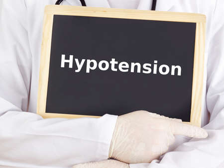 hypotension: Doctor shows information on blackboard: hypotension Stock Photo