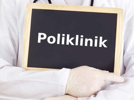 Doctor shows information on blackboard: policlinic Stock Photo