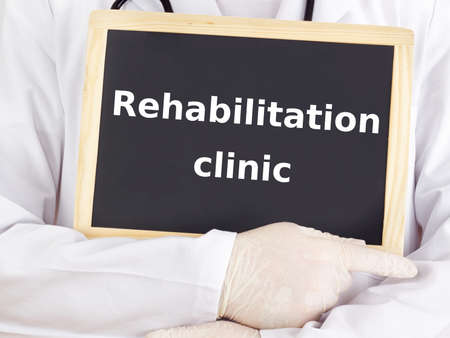 Doctor shows information: rehabilitation clinic