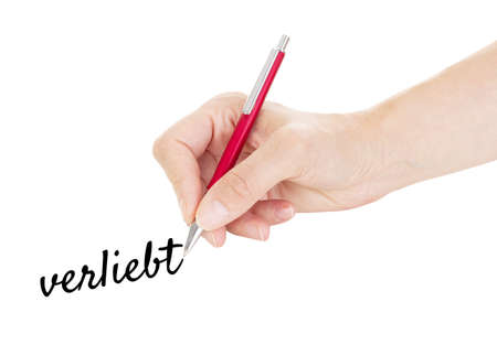 Hand with pen isolated on white background photo