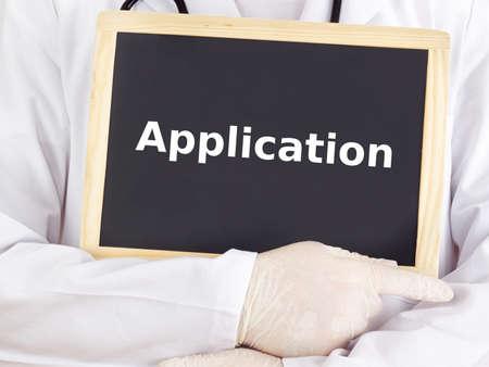 Doctor shows information on blackboard: application photo