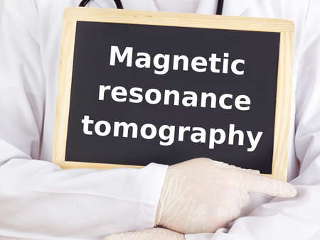 Doctor shows information: magnetic resonance tomography photo