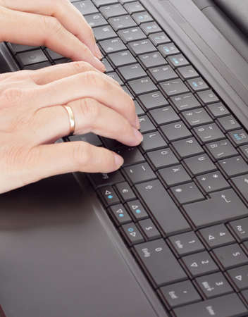 Person typing on the computer photo