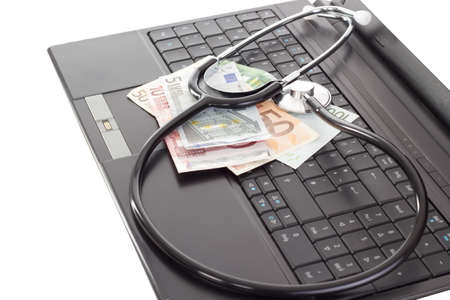 Stethoscope lying on the keyboard photo
