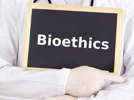 bioethics: Doctor shows information on blackboard: bioethics