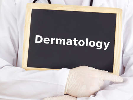 Doctor shows information on blackboard: dermatology Stock Photo
