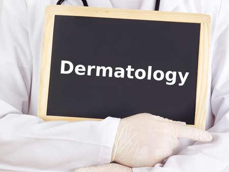 Doctor shows information on blackboard: dermatology Standard-Bild