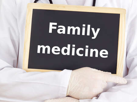 Doctor shows information on blackboard: family medicine photo