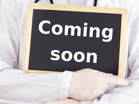 Doctor shows information on blackboard: coming soon